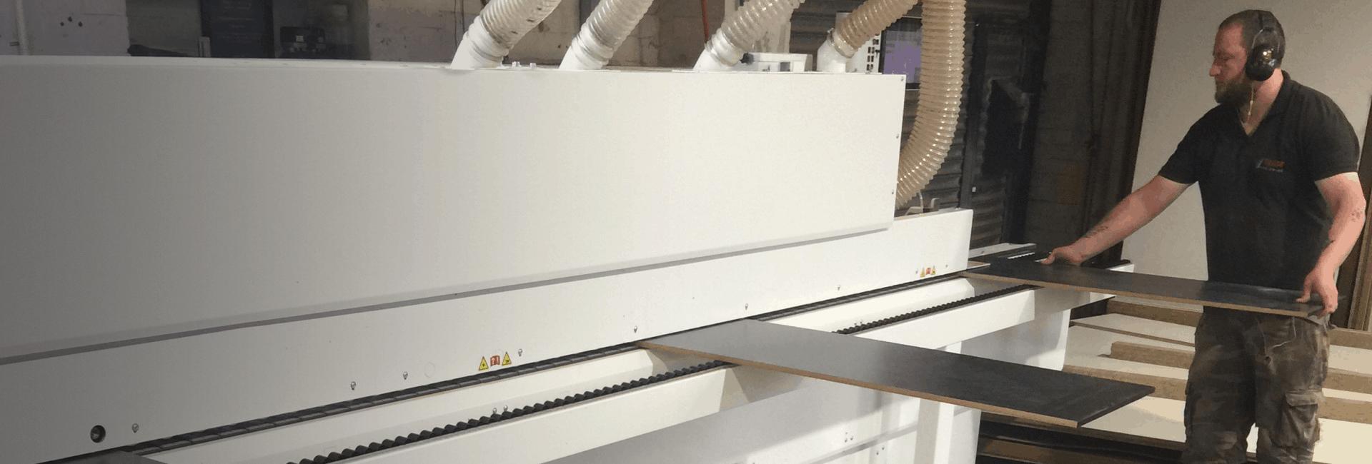 Edgebanding panels in machine
